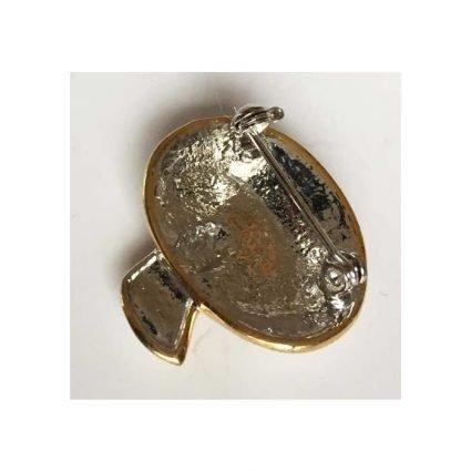 Brosch, guldfärg med vita stenar, baksida