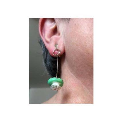 Clips, gröna/lila, på öra