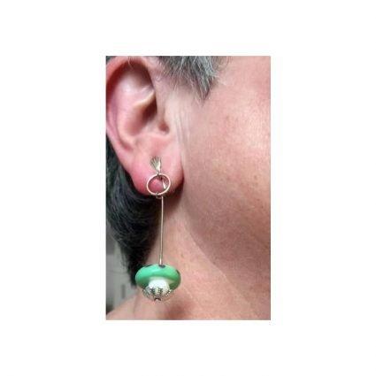 Clips, grönaolila, på öra